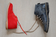 Men's And Female Boot On A W...
