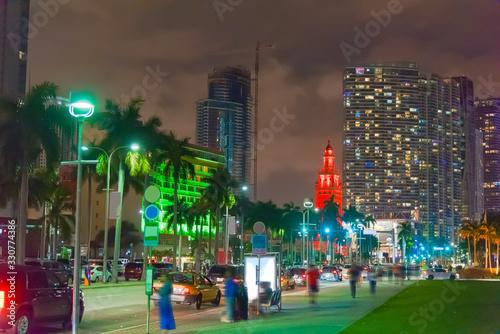 Fototapeta Downtown Miami under a cloudy sky at night obraz na płótnie
