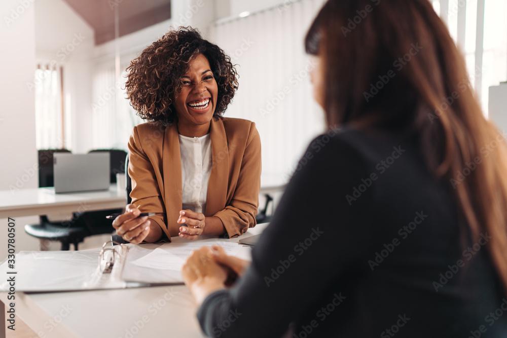 Fototapeta Female financial advisor consulting a client