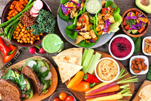 Healthy Lunch Table Scene With Nutritious Buddha Bowl, Lettuce Wraps, Vegetables, Sandwiches And Salad. Above View Over A Wood Background.
