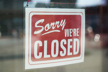 Sorry We're Closed Sign Behind...