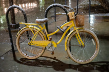 A Woman's Yellow  Bike With Ta...