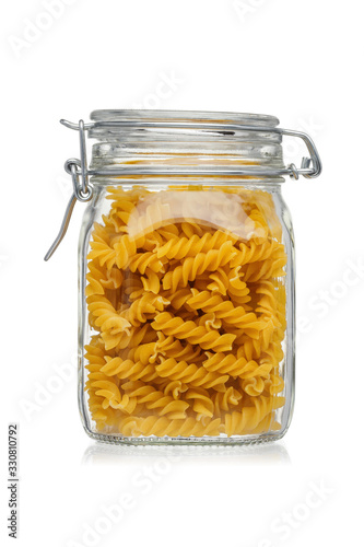 Stampa su Tela Pasta in a glass jar isolated on white background.