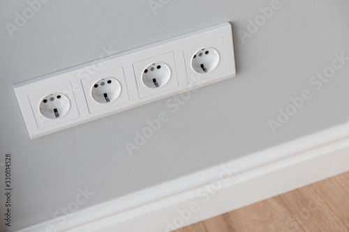 White European sockets on gray concrete wall in loft style, with high polyuretha Wallpaper Mural