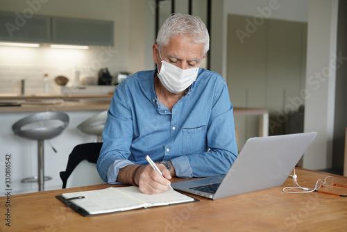 Fototapety, obrazy: Senior man teleworking, stopping virus spreading