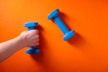 Girl Takes A Blue Dumbbell In ...