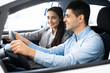 canvas print picture - Wife And Husband Choosing Car In Dealership Shop