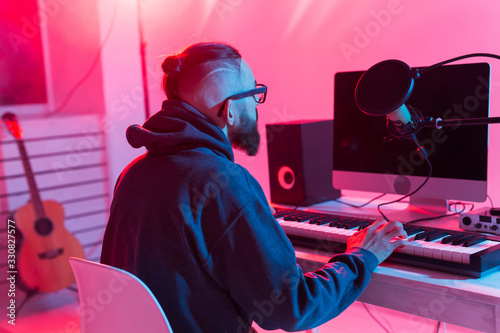 Musician and making music concept - Male sound producer working in recording studio Wallpaper Mural