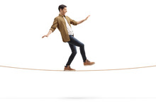 Young Man Walking On A Rope