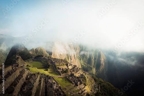 Sunrise with fog in the ruins of machu pichu Wallpaper Mural