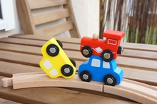 Different Wooden Toy Cars On Wooden Tracks