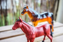 Plastic Horse Toys On A Wooden...