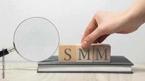 Vászonkép SMM abbreviation on wooden cubes