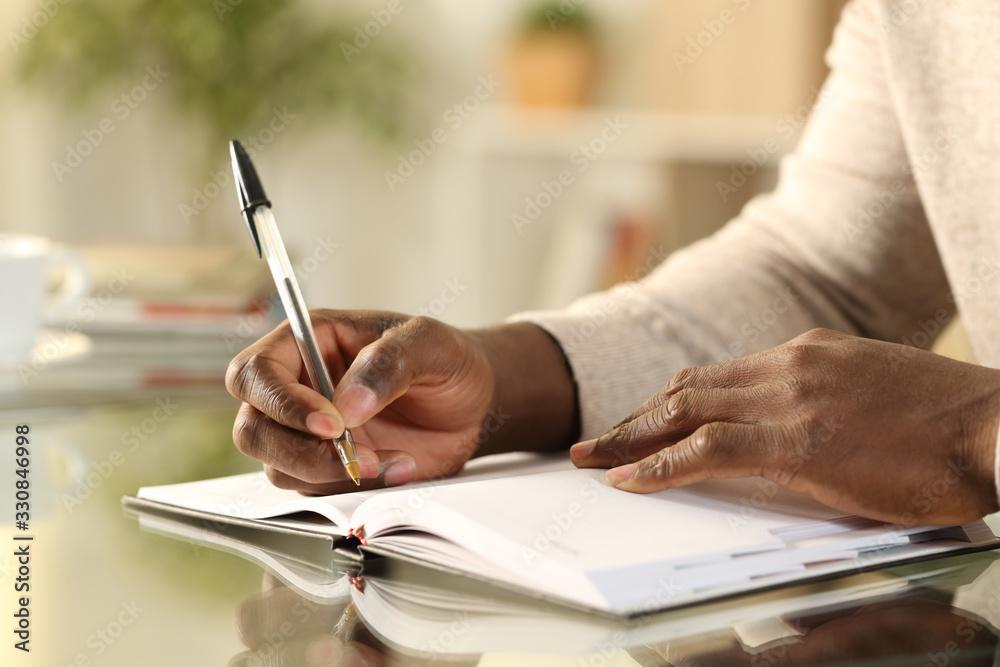 Fototapeta Black man hands writing reminder on agenda
