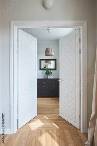 a tall white double door to the bedroom