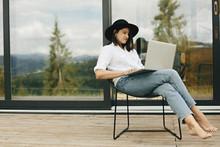Stylish Hipster Girl Sitting W...
