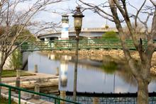 Boom Island Park Marina Lighthouse Foot Bridge Over Mississippi River Channel Plymouth Ave Bridge.  Minneapolis Minnesota USA