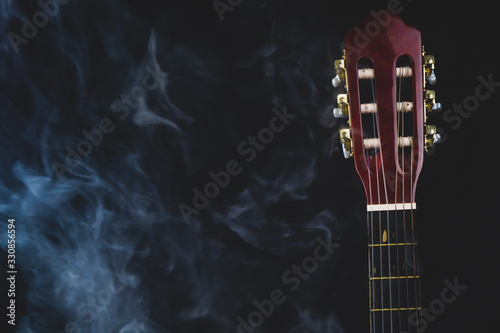 Acoustic guitar in smoke on the black background Fototapet