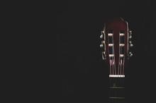 Guitar Headstock On Black Back...