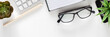 Leinwanddruck Bild - Office desk with white empty space for text. Copy space. Keyboard, open notebook, glasses and plants. Office accessories. Marble pattern. Panoramic photo