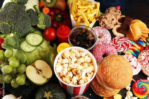 Obraz healthy or unhealthy food. Concept photo of healthy and unhealthy food. Fruits and vegetables vs donuts,sweets and burgers - fototapety do salonu