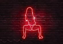 Neon Sign On A Brick Wall In T...