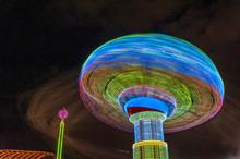 Rides At A Carnival At Night