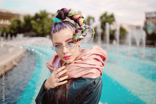 Fashionable Funky Girl Portrait with an extravagant look on streets Canvas Print