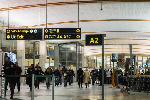 Photo Oslo / Norway - November 30 2019: people at Gardermoen airport terminal for depa