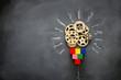 Leinwandbild Motiv Education concept image. Creative idea and innovation. Wooden gears light bulb metaphor over blackboard