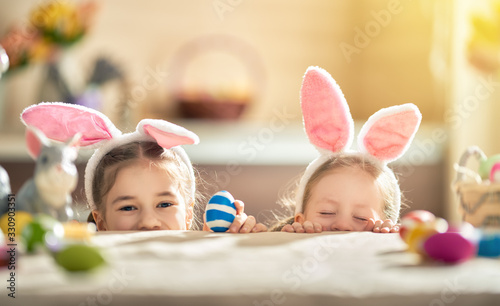 Leinwand Poster children wearing bunny ears on Easter day