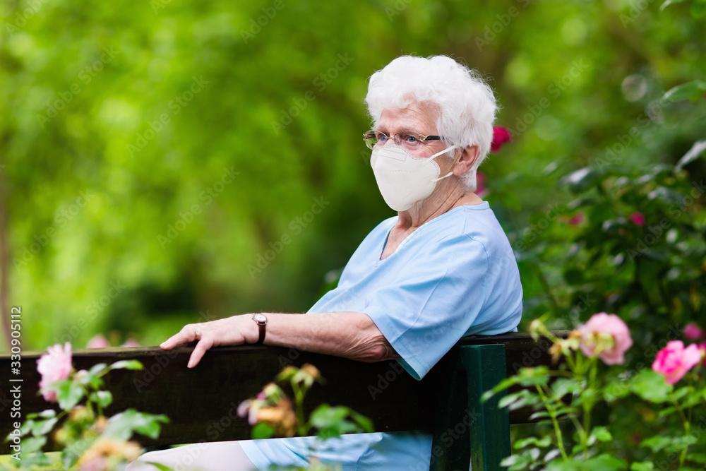 Fototapeta Senior woman in face mask. Virus outbreak.