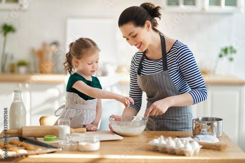 Fototapeta family are preparing bakery together obraz