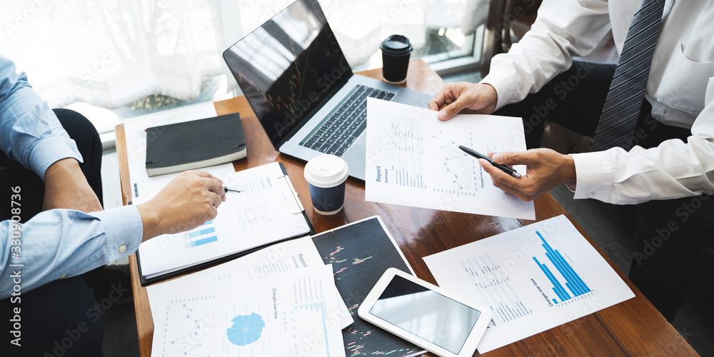 Fototapeta Business executives discussing a data documents in modern office.