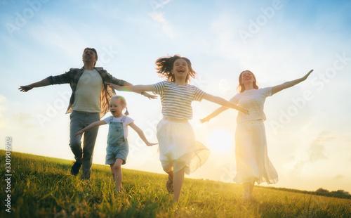 Fototapeta Happy family on summer walk obraz