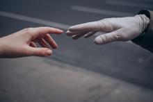Bare Hand Reaching Towards Glo...