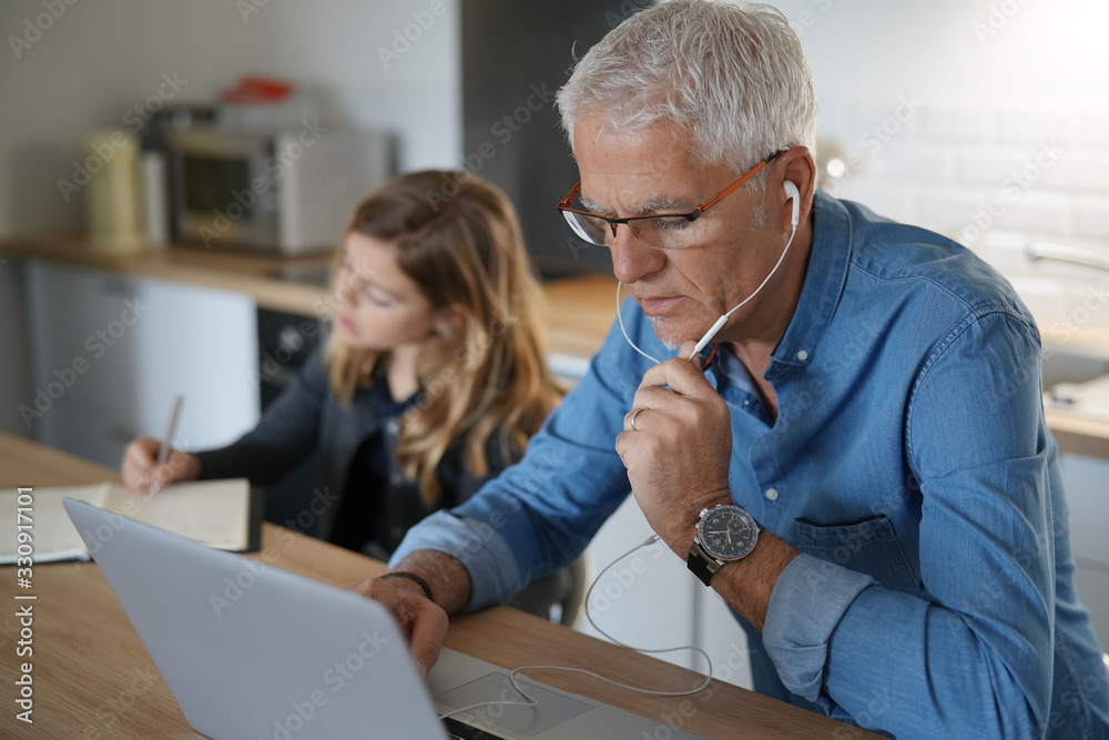 Fototapeta Father and school-girl working form home, telework and e-learning