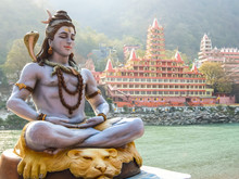 Rishikesh, India. Statue Of Shiva Sitting In Meditation On The Riverbank Of Ganga In Rishikesh.
