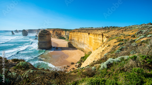 12 apostles on the great ocean road under clear blue sky in Victoria, Australia