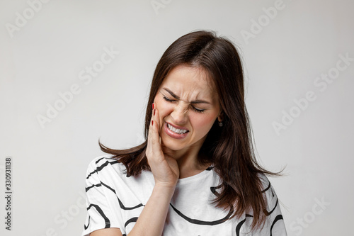 Fotografia young sad woman suffering from tooth pain, caries