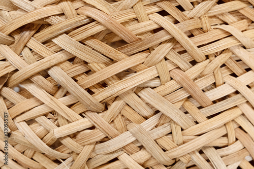 Obraz Closeup texture of wicker basket in beige color. Natural materials in the industry. No waste. Recycling. Background and texture. - fototapety do salonu