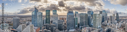 Canvastavla Aerial panoramic drone shot of La Defense skycraper in Paris with clouds and sun