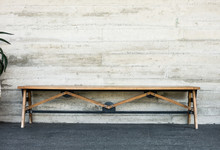 Wooden Bench On White Grunge Wall