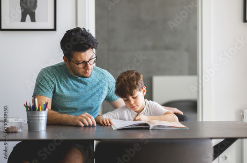 Father and Son doing homework Together Canvas Print