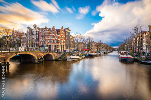 Amsterdam, Netherlands famous canals and bridges at dusk. Canvas Print