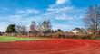 canvas print picture - Sportplatz hinter einem Schulgebäude in Berlin Pankow