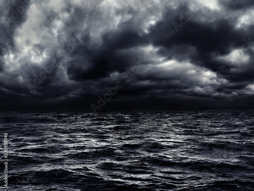 Fototapeta dark stormy sea with a dramatic cloudy sky obraz