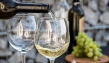 Waiter Pouring White Wine On O...