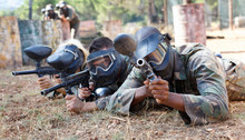 Paintball Players Aiming And S...