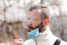 A Guy In An Antiviral Mask Tak...